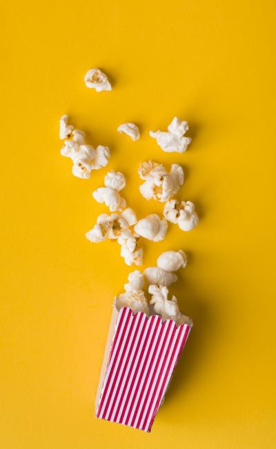 flat-lay-popcorn-yellow-background